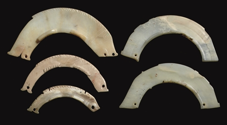 FIVE ARC-SHAPED PENDANTS, LATE