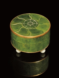 A NEPHRITE AND GILT METAL CIRC