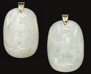 A WHITE AND RUSSET JADE FIGURA