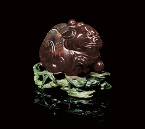 AN AMBER CARVING OF A QILIN SE