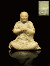 A SOAPSTONE CARVING OF A MONK,