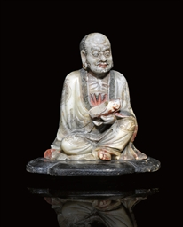 A SOAPSTONE CARVING OF A SEATE