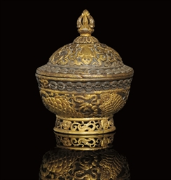 A TIBETAN RITUAL BOWL AND COVE