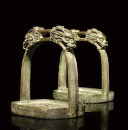 A PAIR OF BRONZE STIRRUPS, MIN