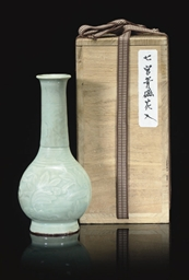 A SMALL CELADON BOTTLE VASE, 1