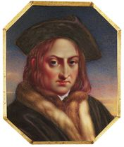 A gentleman, in fox fur-lined black robe, fur vest, white shirt, brown leather four-cornered hat, wavy auburn hair