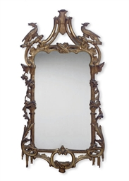A CARVED GILT-WOOD WALL MIRROR