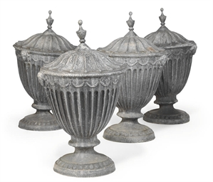 A SET OF FOUR LEAD GARDEN URNS