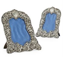 A MATCHED PAIR OF VICTORIAN SILVER PHOTOGRAPH FRAMES