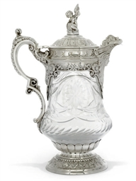 A CUT-GLASS CLARET JUG WITH EL