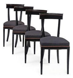 A SET OF FOUR EBONISED DINING
