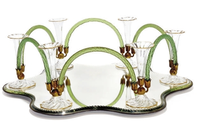 A GLASS TABLE CENTREPIECE