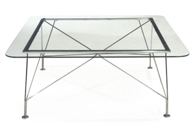 A GLASS AND CHROME TABLE