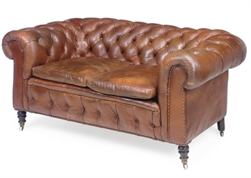 A BUTTONED LEATHER CHESTERFIEL