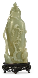 A CHINESE PALE CELADON JADE BA