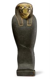 AN EGYPTIAN GILT WOOD FALCON S