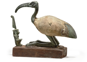 AN EGYPTIAN BRONZE AND WOOD GR