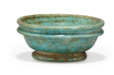 AN EGYPTIAN FAIENCE BOWL