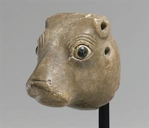 A SUMERIAN LIMESTONE BULL-HEAD