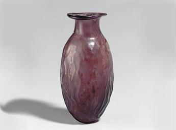 A ROMAN GLASS DATE FLASK