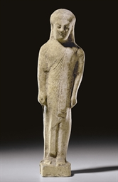 A GREEK TERRACOTTA KOUROS