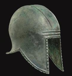 A GREEK BRONZE HELMET OF ILLYR