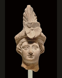 A GREEK TERRACOTTA HEAD OF DIO
