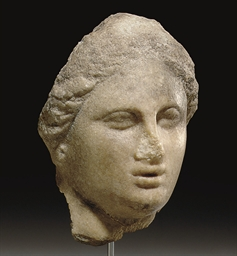 A GREEK MARBLE FEMALE HEAD