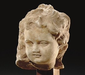 A ROMAN MARBLE HEAD OF A BOY
