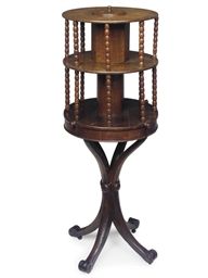 AN ENGLISH OAK TWO-TIER REVOLV