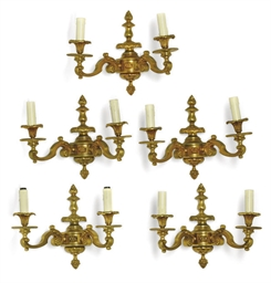A SET OF FIVE GILT BRONZE WALL