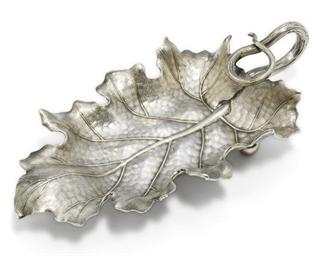 A trompe l'oeil silver dish