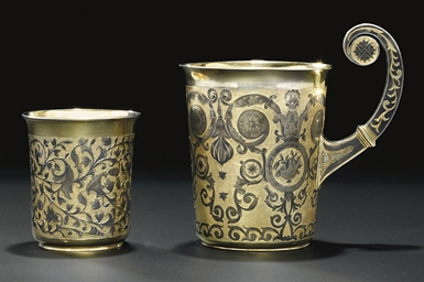 A parcel-gilt and niello mug a