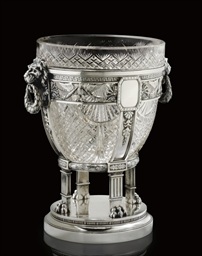 A silver-mounted cut-glass cen