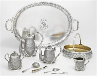 A silver trompe l'oeil tea and