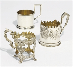 Three silver and tea-glass hol