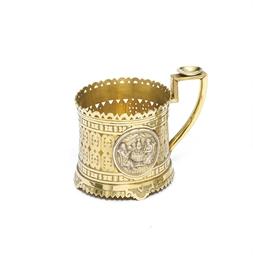 A silver-gilt tea-glass holder