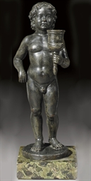 A BRONZE FIGURE OF A PUTTO IN
