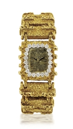 EBEL  LADY'S YELLOW GOLD AND D