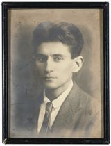 [KAFKA, Franz (1883-1924)]. A portrait photograph of Franz Kafka, bust length, [late 1917], REPUTEDLY THE PORTRAIT BELONGING TO THE WRITER'S MOTHER, 221 x 168mm, framed and glazed; [with] a portrait photograph of Kafka, three-quarter length, [in 1906, after receiving his doctorate in law], by 'American Photo Studio, Prague Vaclavske nam 15', the verso printed with a blank postcard form. Provenance: Kafka's mother, Julie Kafkova (according to her granddaughter, Vera, the framed photograph used to hang above her bed); Ottla Kafkova (1892-1943, Kafka's favourite sister); her daughter Vera Projsova-Saudkova; collection of her first husband, Karel Projsa (1912-1972); acquired by Vaclav Cihak, together with the collection of Kafka's last letters to his family, 1922-24, which were published in Franz Kafka. Diposy rodicum z let 1922/1924 (Prague, 1990); given by him to Dr Martin Krajicek; presented by him to the present owner (information from an accompanying letter by Dr Martin Krajicek).