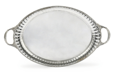 AN OVAL SILVER TWO-HANDLED TRA
