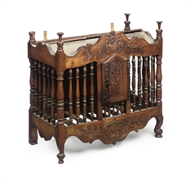 A FRENCH PROVINCIAL CARVED AND
