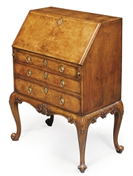 A GEORGE II WALNUT BUREAU-ON-S