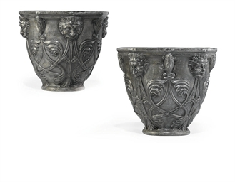 A PAIR OF GEORGE III LEAD URNS