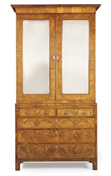 A GEORGE II WALNUT CABINET-ON-