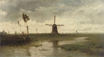 Windmills in a river landscape