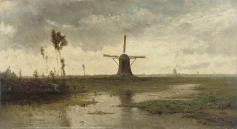 Windmills in a river landscape