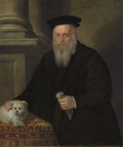 Portrait of a bearded man in a black coat and hat, his dog on a table beside