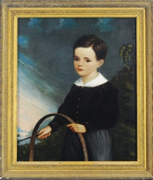 Portrait of a boy playing with