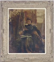 Seated woman in a studio looki
